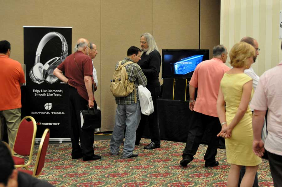 Ron Meyerowitz showing a dealer around the show