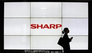 Photo of woman walking past Sharp sign