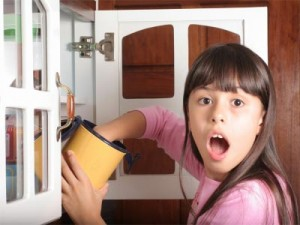 Photo of girl caught with hand in cookie jar