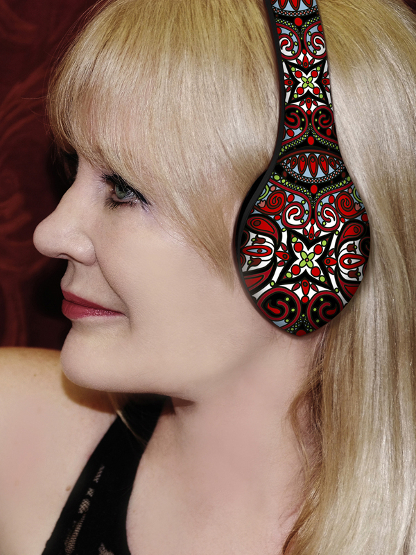 Photo of Velodyne President modeling headphones