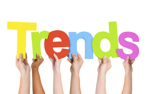 Multi Ethnic People Holding The Word Trends