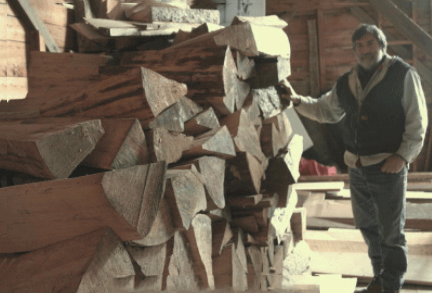 Photo of Tom Thiel selecting wood