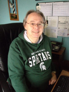 Photo of Ted Green in Spartan sweatshirt