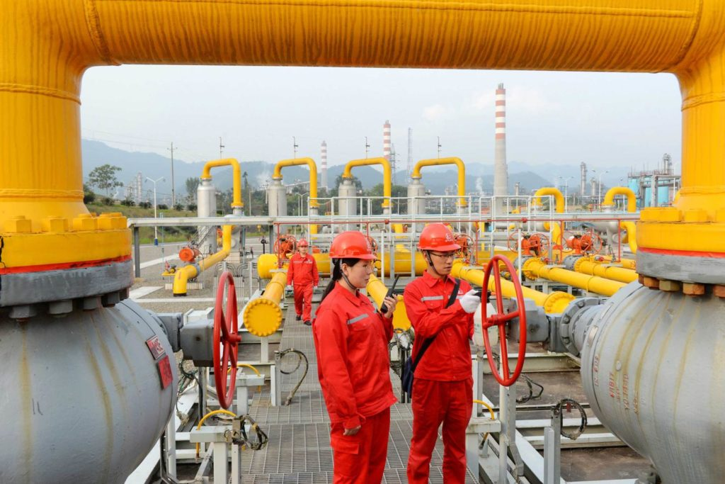 China leads the world as suggested by this photo of Chinese petrochemical workers