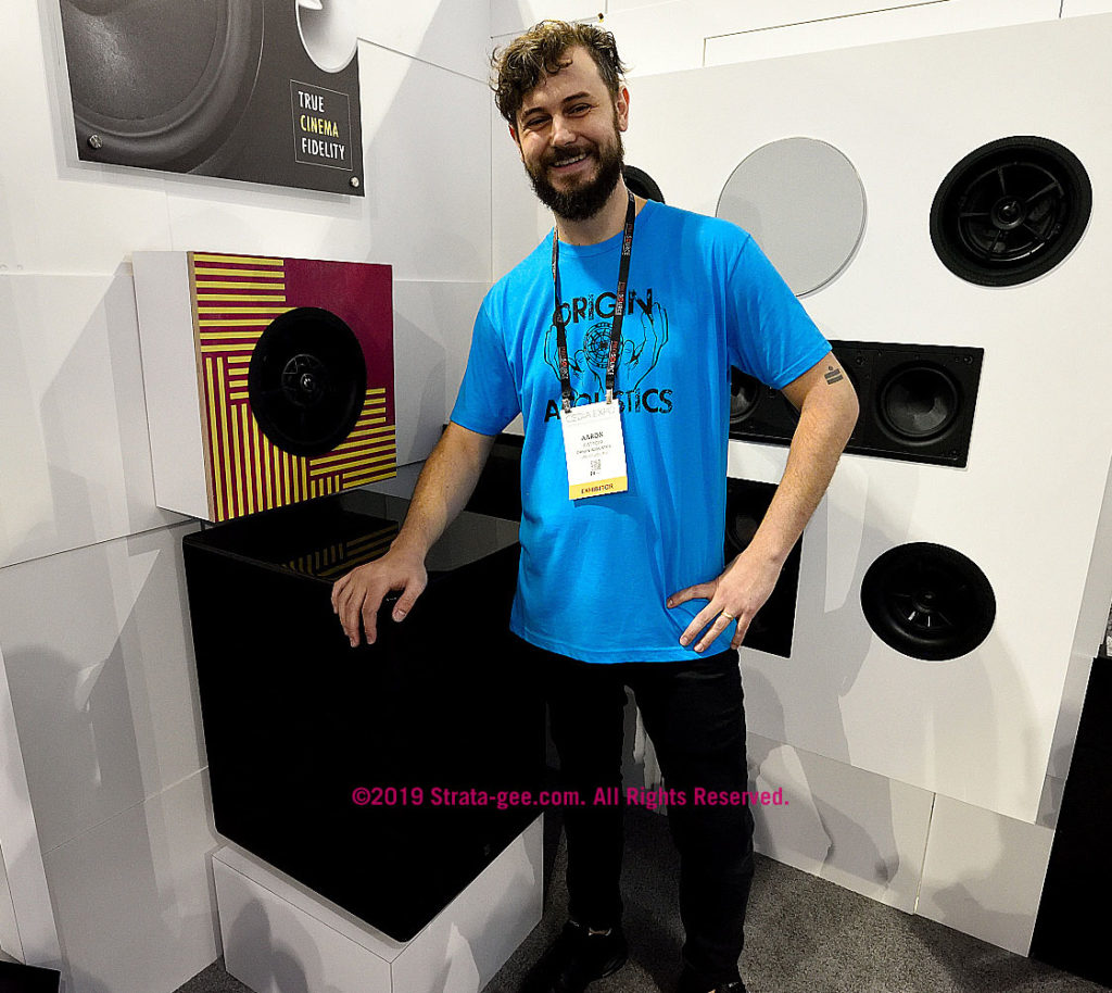 Origin's Aaron Cattoir at CEDIA19 with a big subwoofer