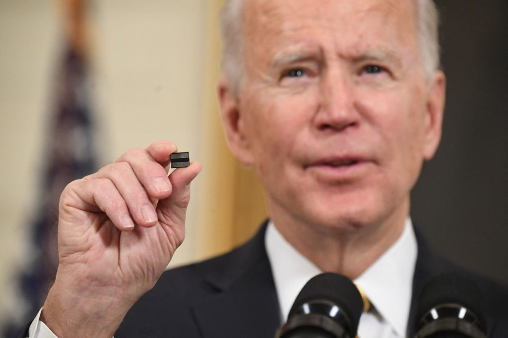 president biden holds up a semiconductor